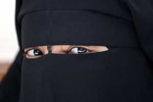 """Woman wearing a Burqa / September 14, 2010, the French Senate passed into law Act No. 2010-1192 - """"Loi interdisant la dissimulation du visage dans l 'espace public' – preventing the use of face-covering in public space, the first of its kind in the European Union. The act became known publicly as """"the Burqa Law""""."""