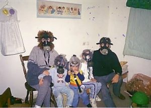 Winter, Hefer Valley, Israel, 1991 // An Israeli family in a bomb shelter, all wearing ABC (Atomic/Biological/Chemical Weapons) masks, Image by Jane Fresco, Herzliya, from Wikipedia